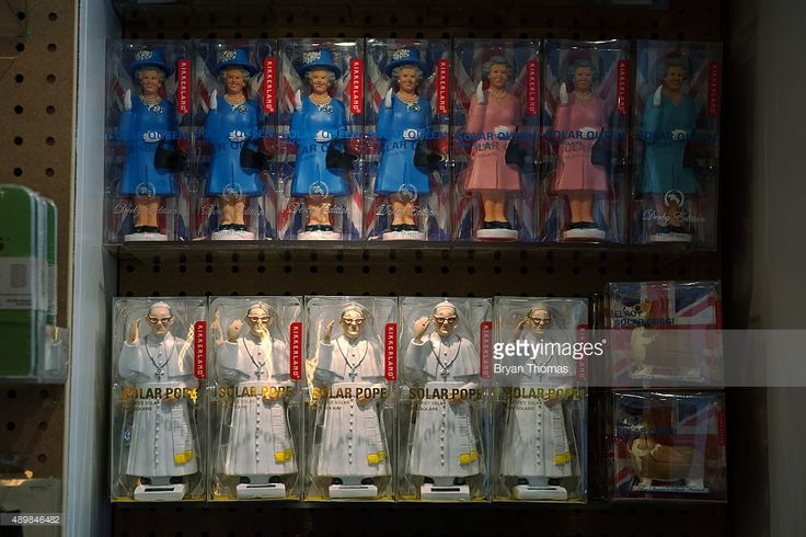 Pope toys are displayed on the walls of Kikkerland on September 24, 2015 in New York City. Pope Francis, who is traveling to The United States for the first time as Pope, arrives in New York on the evening of September 24, before leading an evening prayer at St. Patrick's Cathedral.