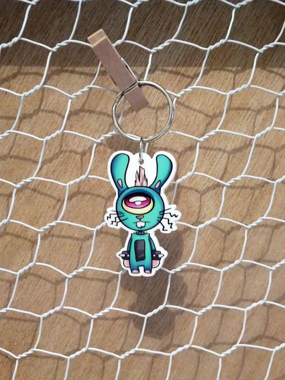 'Rocker Rabbit' acrylic keychain.  He's got one good eye for fashion.  ---  Original design on die cut acrylic. White on back. Aprox 4.5cm x 3 cm charm
