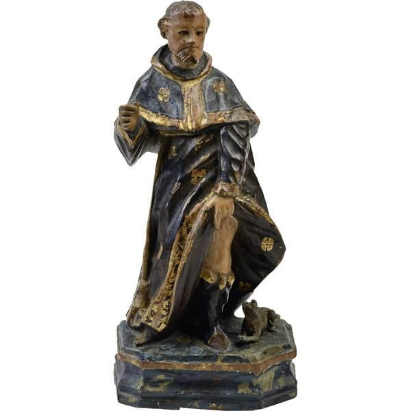 Walnut carving of St Roch in characteristic pose exposing a plague wound on his thigh and with a dog by his side, decorated with gilt and polychrome on gesso, the original stand marbelised. Spain, late 17th century