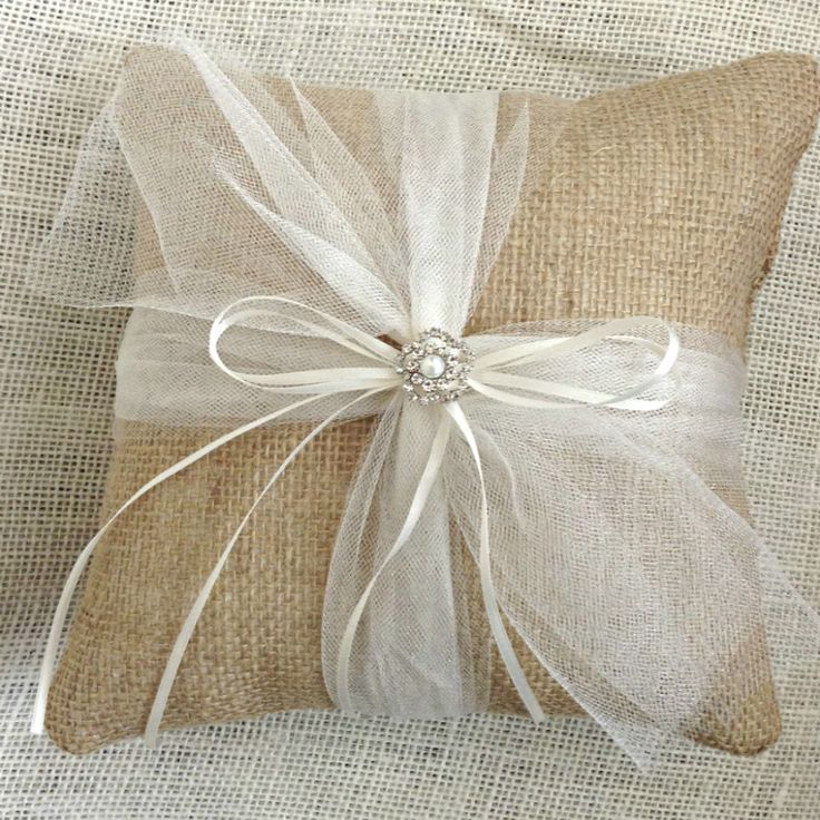 This Burlap Ring Bearer Pillow marries the wonderful rustic value of burlap with the sweetness of shimmery tulle to make a perfect match for your wedding. Measuring 9x9 inches, this burlap ring pillow
