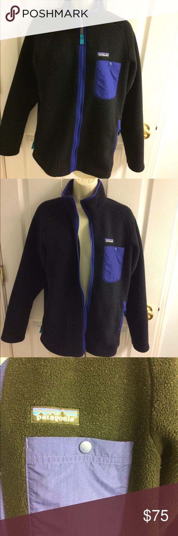 Patagonia men SYNCHILLA  jacket size - small. Patagonia SYNCHILLA men full zippered jacket with 2 side zippered pockets in a bold black and beautiful purple and teal accent colors with the signature Patagonia logo on the left side of the jacket right above the purple snap close pockets all zippers have teal pulls and work without issues this jacket is is immaculate condition it is just waiting for you so that it can keep you warm this is a hard to come by color combination do not let it pass…