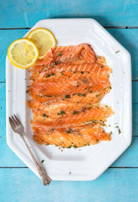 """FROM ISSUE #166A salt and sugar cure flavored with fresh dill transforms salmon into gravadlax, silky ribbons of fish ready to be piled atop slices of rustic brown bread or crunchy rye crispbread for a Swedish Midsummer feast. This recipe first appeared in our June/July 2014 issue with Per Styregård's article """"A Midsummer's Dream."""""""