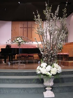 concept to fruition, large altar arrangement in urn, plum tree branches, hydrangeas, roses
