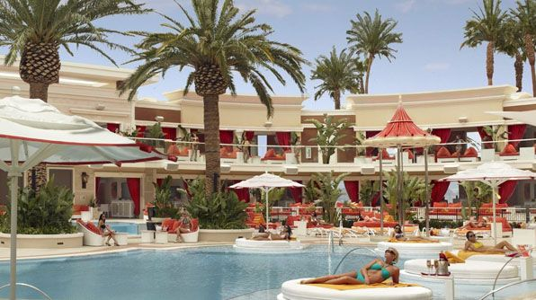 Encore Beach Club at the Wynn~possibly the biggest pool party in Vegas, larger then a football field & packed with bodies in bikinis & board shorts, the Encore Beach Club is surrounded by 40' palm trees.