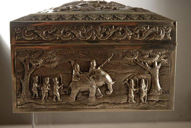 Image from http://www.jamesbaldwinantiques.com/gallery/p_441/A_Burmese_Large_Silver_Cigar_Box_with_Elephant_Battle_Scenes-03.jpg.