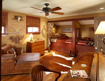 A little buckaroo's dream bedroom by Graf Development. A western wall mural, cowhide, and bunkbeds make this bedroom perfect for a western k...