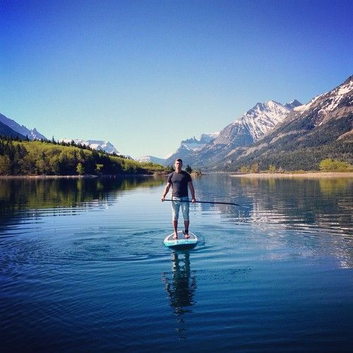 Insert yourself here! As in today, it's partly cloudy now, but the lake is still calm and the temperature is heating up. #liveinsidethepostcard We're just behind the Crandell Mountain Lodge. #Waterton #Watertonlakes #lake #rockymountains #SUP #experiencewaterton #SOAB #standuppaddle #adventure #water Best way to see wild life! #wildlife #fish #bears #baldeagles All of which I've seen paddling.