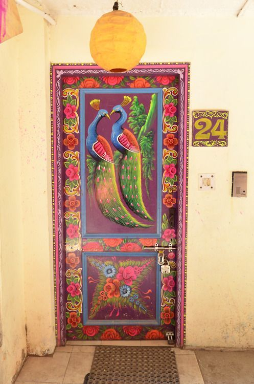 Painted peacocks on a door in India