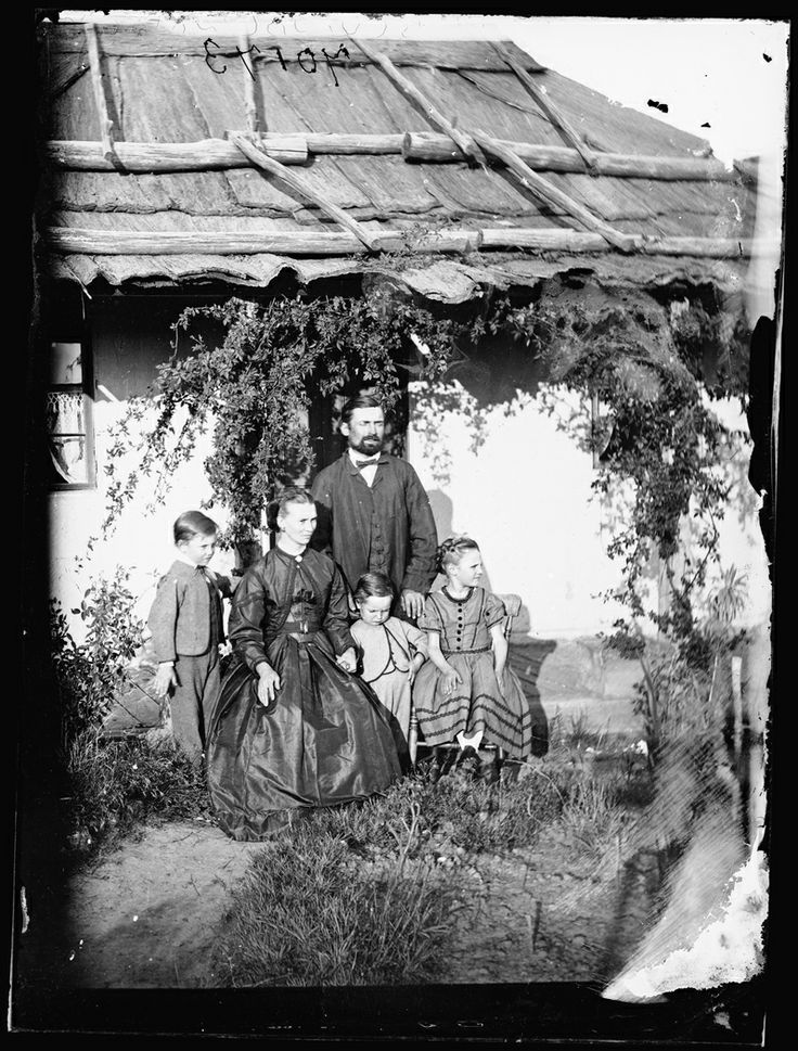 Early Australians settlers standing outside of their homes (1870-75), Photo shared by the State Library of New South Wales. v@e.