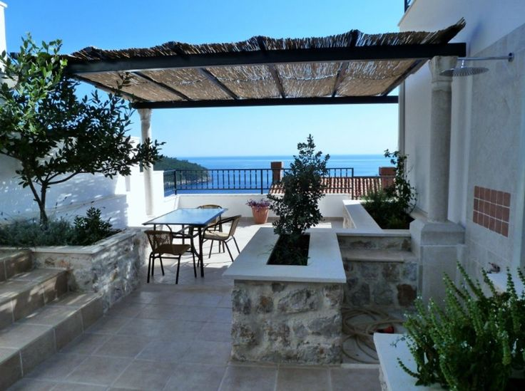 Dubrovnik apartment rental - Spacious shaded terrace with sea view: ideal for outdoor dining or sunbathing.