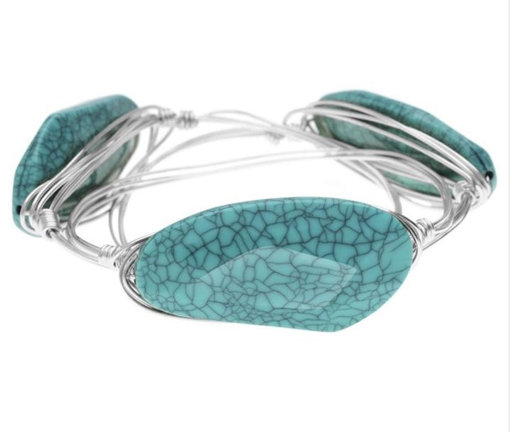 A personal favorite from a cool shop https://www.etsy.com/listing/506133568/turquoise-stone-wire-wrapped-bangle
