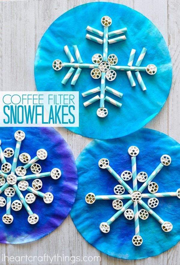 Painted coffee filters, pinwheel pasta and paper straws come together to create awesome texture in this fun kids snowflake craft. Great winter kids craft and symmetry activity for kids. #snowflakecraft #wintercrafts #winteractivitiesforkids #winteractivity #kidcraftideas #kidcrafts #craftsforkids