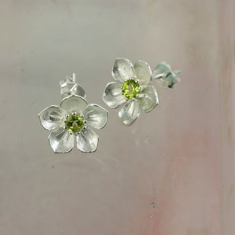 """Peridot Posy Earrings £29.00 Treat yourself or someone else to these sterling silver and green peridot flower stud earrings All of our silver jewellery comes beautifully packaged in our new Christin Ranger branded boxes. Look for us in the September issue of """"Good Housekeeping""""."""