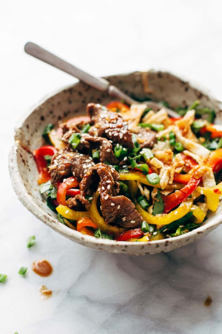 Korean BBQ Steak Bowls with Spicy Sesame Dressing - a healthy, crazy delicious recipe that is ready in 20 minutes!   pinchofyum.com
