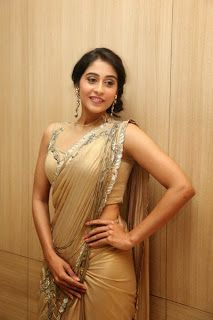 Regina Cassandra was seen at the Travel New Roads Magazine Launch. She was looking so pretty in the Coffy Color Saree with open hairy style.
