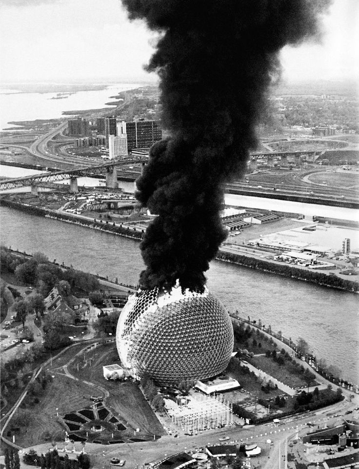 The US Pavilion for Expo 67 engulfed in flames after a fire broke out during structural renovations. Montreal, May 20, 1976.