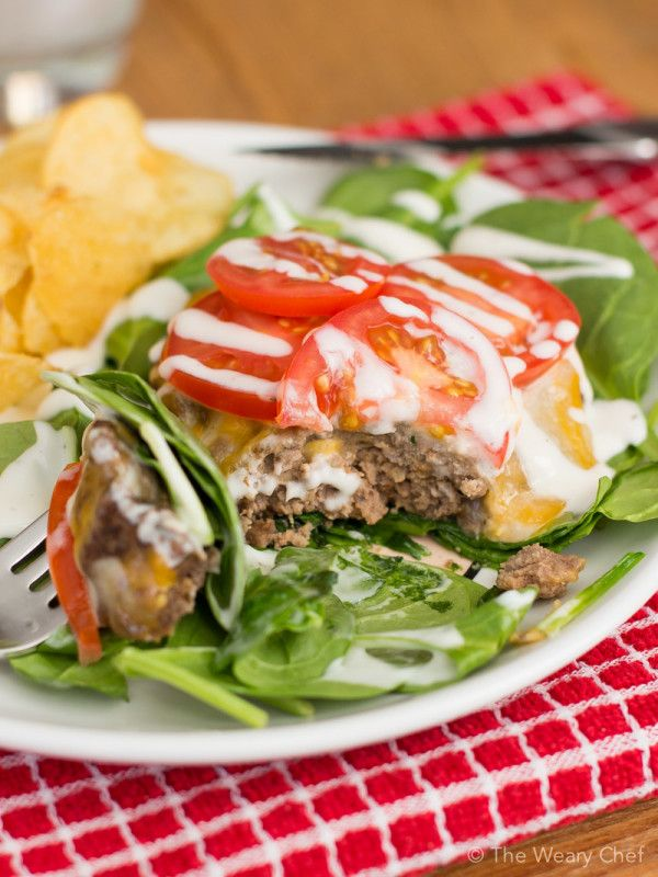 Try a juicy beef patty on a bed of baby spinach topped ...
