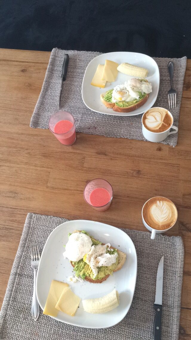 Poached egg on avocado toast, side of banana and cheese slice. Mango, raspberry, yogurt smoothie and cantook latte!
