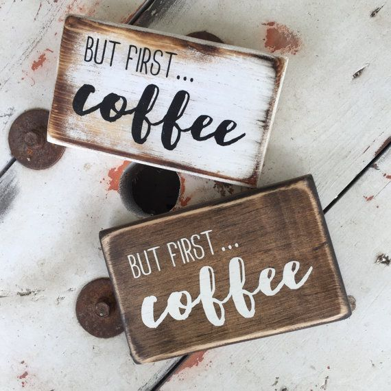 but first, coffee - rustic, farmhouse style wooden sign painted in black over a white distressed board. Or alternatively, we can stain the board and paint in ivory. Perfect to sit or hang right beside the coffee maker!  This sign is 5x 7. Size may vary by 1. The back is unfinished and comes with wall hangers.  Please note this is a made to order listing, so please be aware of the processing time.  If you would like custom colors, please message us prior to purchasing.  Be sure to check out…