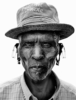 Lyle Owerko - Samburu tribe series.  Owerko has dedicated massive amounts of time and effort into documenting this African tribe which is running the risk of cultural assimilation. You can see signs of this in some of his photographs: tribesmen with keychains, Western clothes, and crucifixes.