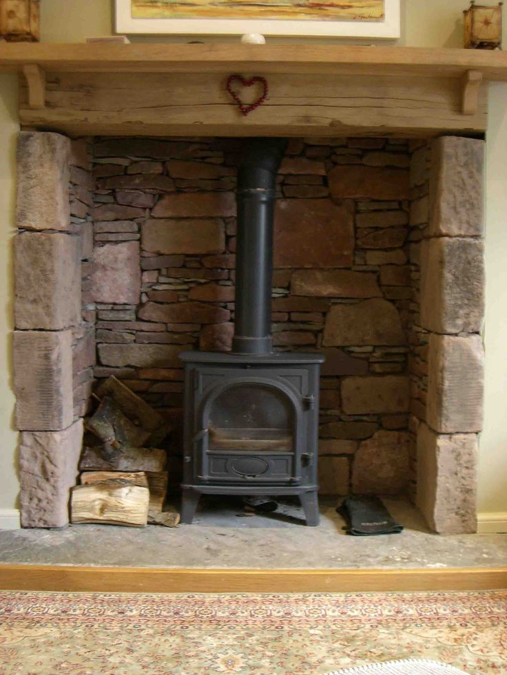 http://www.jmlcontracts.co.uk/wp-content/uploads/Reclaimed-stone-fireplace-hearth1.jpg
