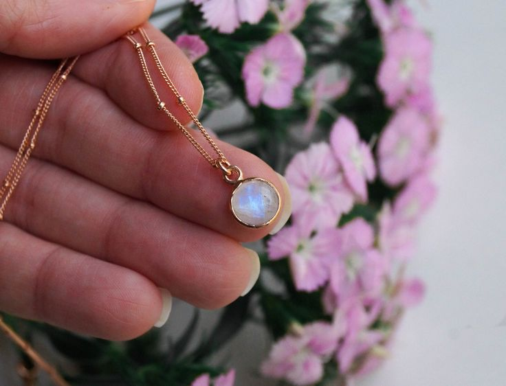 Our Tiny Moonstone Necklace in rose gold is the perfect everyday dainty necklace!  https://www.wanderandlustjewelry.com/products/tiny-moonstone-necklace