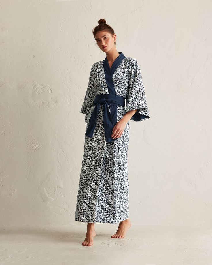 Crisp, lightweight, hand block printed cotton. Traditional kimono sleeves. Patch pockets. Wide, wrappy tie. Full length.