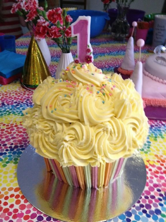 Giant vanilla cupcake with buttercream, perfect for a first birthday cake smash!