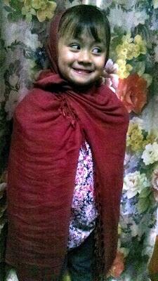 My niece, Ilwanaihun in the traditional Khasi shawl :)