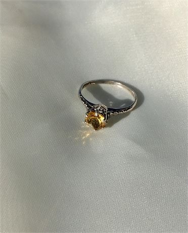 This vintage,cupid, love arrows, filigree, Art Deco ring,is in good vintage condition. Its got a single prong that is lifted slightly,the stone is not loose, but it will catch fuzz. Stamped STER with a natural, round cut, .5 ct.citrine, this ring would make a great alternative engagement ring or November birth stone. Size 5.75 1 gram
