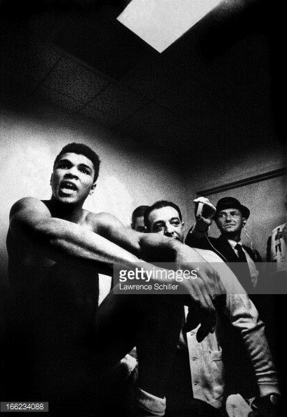 American boxer Muhammad Ali sits with unidentified others in his dressing room in the Convention Center Las Vegas Nevada November 22 1965