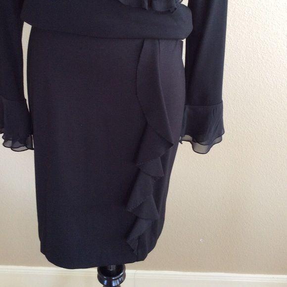 NWT Little Black Skirt Little Black Skirt. Knit with ruffle down the left hip. Back zipper. NWT Skirts