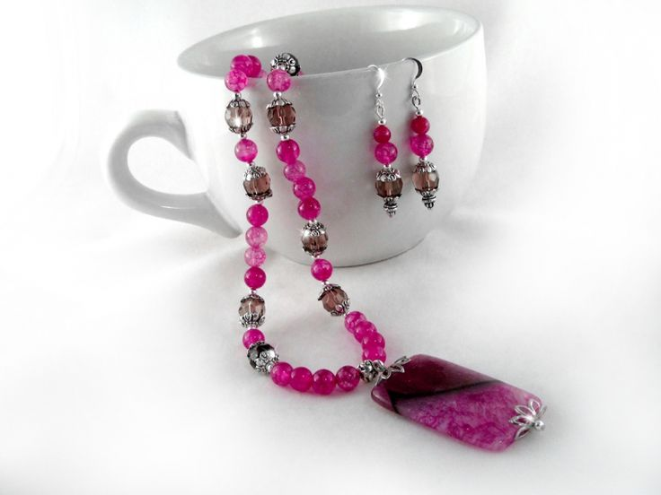 Magentina jewelry Set $33.00 Pink Fire Agate Druzy, magenta Dragon agate, Wine color Czech fire polished faceted glass beads, and Tibet silver are combined together for a stylish look. The necklace is strung onto tigers tail wire for strength, durability and drape. Finished off with an ornamental vine leaf shaped toggle clasp. The earrings are strung onto silver plated wire.