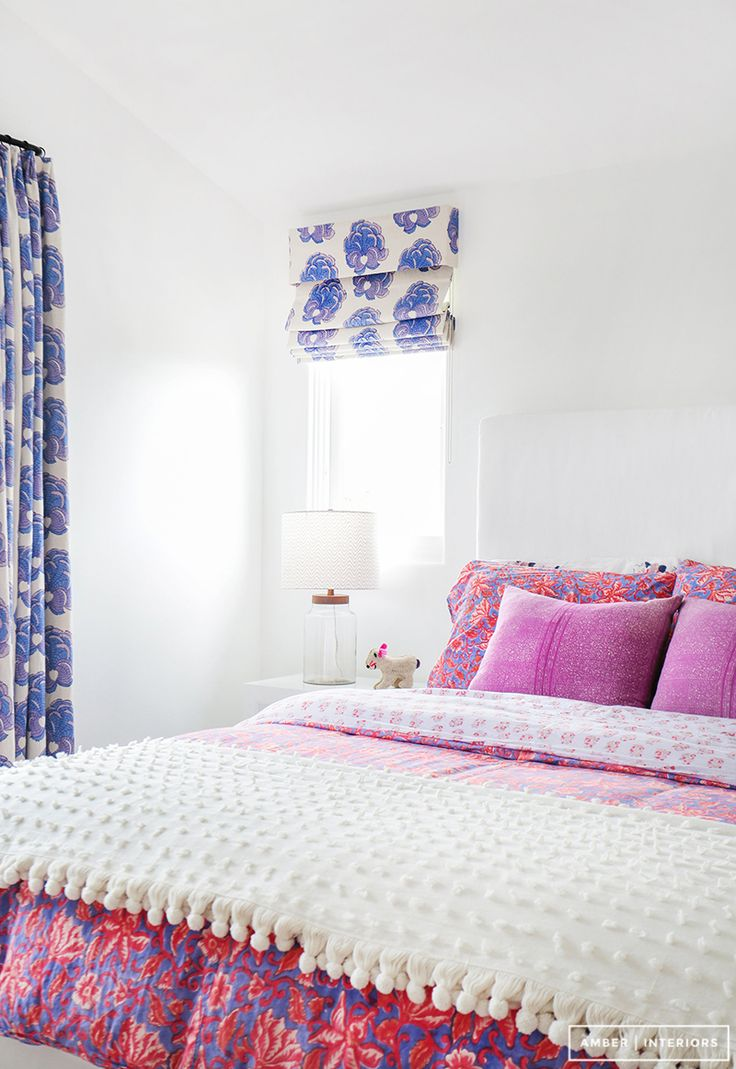 Bold color and pattern in this feminine little girl's room