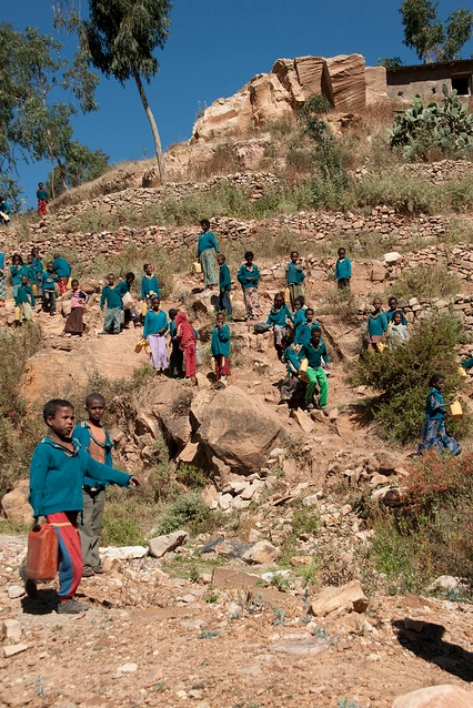 Students leave school to fetch water in Tigray, Ethiopia--BEFORE there was improved access thanks to Voss Foundation and Water.org!