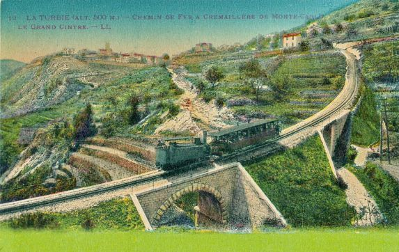 Postcards Monaco - Une ligne de chemin de fer à crémaillère reliait Beausoleil à La Turbie de 1893 à 1932.  située au bord de la mer Méditerranée, le long de la Côte d'Azur, à proche de Nice et de Menton, ville frontalière avec l'Italie.
