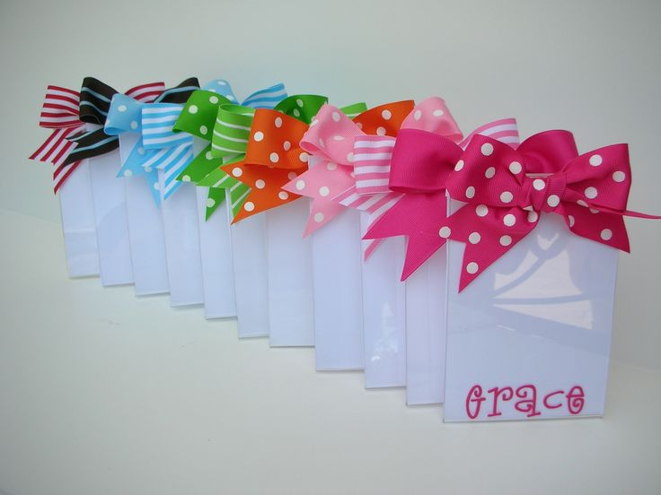 Cute - these $1 store frames and add a bow and paint the name.... cute gift for my kid's friends!
