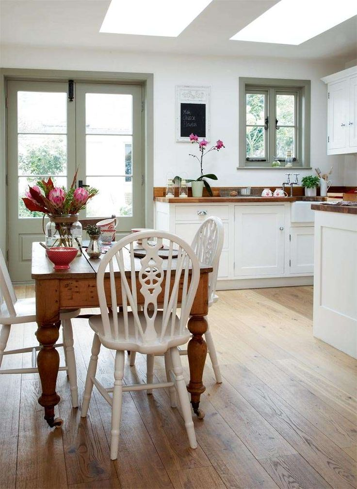 Gorgeous kitchen, love the skylights, grey painted door and wide boards