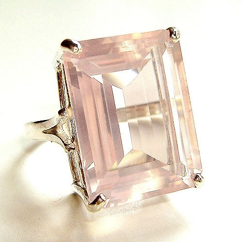 14k Gold Rose Quartz Emerald-Cut Cocktail Ring 21 Carats. Never in a million years would I have thought of this but I am in some kind of love with this rose quartz!! My grandfather used to dig it up on his property and set it in the sun for us to watch it deepen its pink shade.