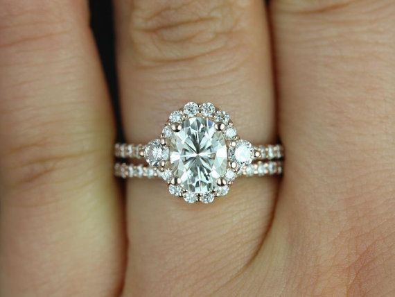 OMGGGGGGGGG this wedding set is designed for those who love simple with a slight twist. with the combination of both the 3 stone and halo together, the ring is.