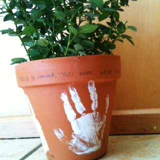 """""""This is to remind you when we've grown so tall, that once our hands were so very small,"""" handprints on pot with date and tea roses or other plant. Gift for parent / grandparent."""