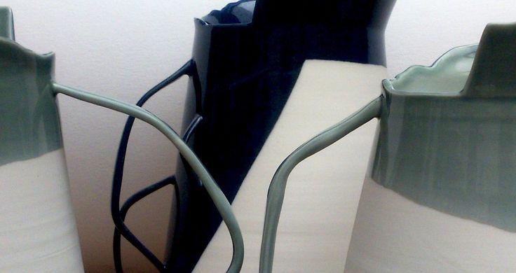 detail: handles. Porcelain vessels with asymmetric edges.