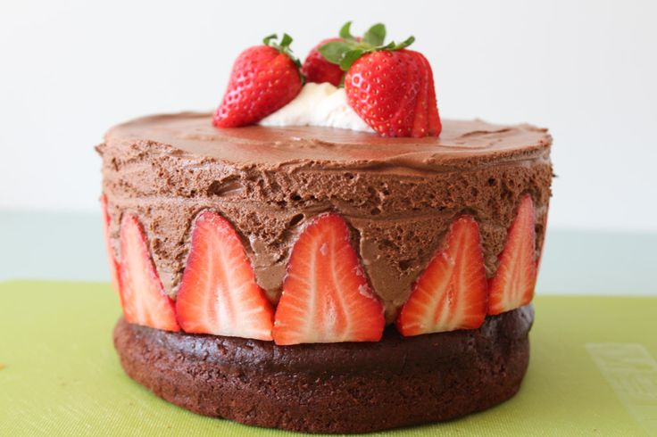 Chocolate cake with chocolate mousse and strawberries