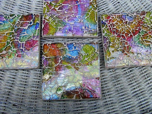 Love this idea of using tempered glass (shattered) over paint and glitter for a mosaic look. Underneath can be wood, tiles, anything firm.