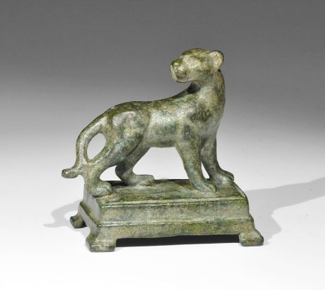 Roman Bronze Panther Statuette Description: A cast statuette of a standing panther with head turned, on a rectangular base with four legs. Culture/Period: 2nd-3rd century AD