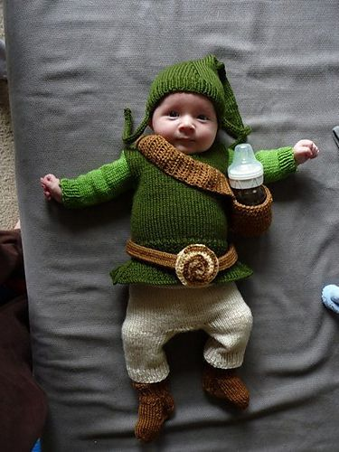 He has a sheath for his bottle! Lots of knitting patterns found at this link.