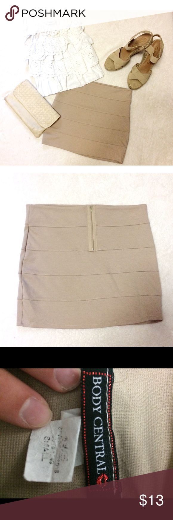 Body Central SZ Small Tan Bodycon Skirt miniskirt Super cute short, tan, bodycon miniskirt from Body Central. Barely worn, like new. Zipper in the back, and the skirt had lots of stretch. The color goes well with pretty much everything! (Skirt only) Body Central Skirts Mini