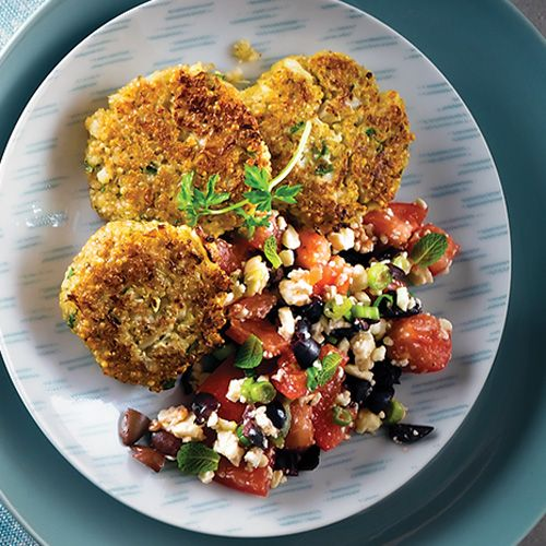 Parmesan, garlic and herbs add big flavor to these easy patties while a fresh, feta-topped tomato and olive mediterranean salad is served alongside.