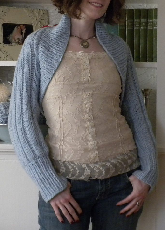 Free Knitting Pattern for Easy Ribbed Shrug - This easy shrug isknit in one piece and seamed. Designed by Erika Knight. Sizes34-36, 38-40, 42-44. Pictured project by honeybeeknits. Excerpted fromGlamour Knits