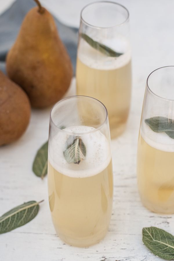 Champagne cocktails with pear, ginger, and sage